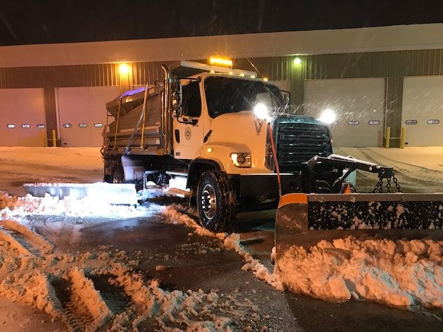 2018 snowplow with wing at night
